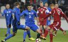 Slováci Pavol Šafranko (vľavo), Matúš Bero (druhý zľava) a hráč Bieloruska Pavel Nazarenko v zápase kvalifikácie ME 2017 hráčov do 21 rokov Slovensko - Bielorusko. Myjava, 7. októbra 2016.
